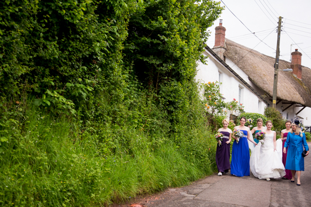 Bride and her bridesmaids on their way to the church | Confetti.co.uk