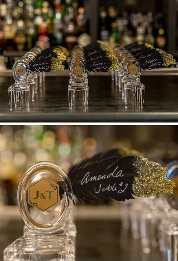 Mini chair place cards with black and gold feather | Confetti.co.uk