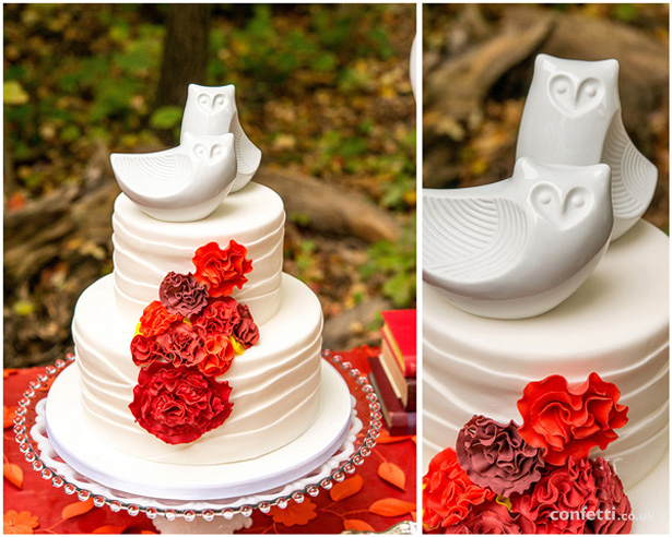 Autumn Wedding Details | Porcelain owl cake toppers | 2 tiered white wedding cake with orange iced flowers and Owl cake toppers | Confetti.co.uk