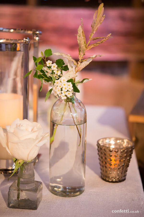 Rustic glass bottle table setting | Wildflower and vintage centrepieces | Confetti.co.uk