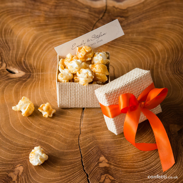 Package a handful of gourmet popcorn in a pretty jewllery box for an instant foodie favour from Confetti.co.uk