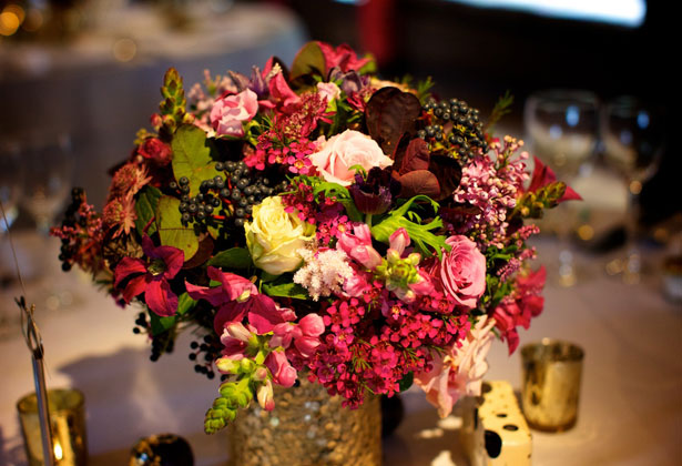 Styling Autumn Wedding| Real Wedding Autumn Wedding Floral Centrepieces | Image courtesy of Ramster Hall | Pink, Ivory Roses with Berries and Gold Autumn Centrepieces |Confetti.co.uk