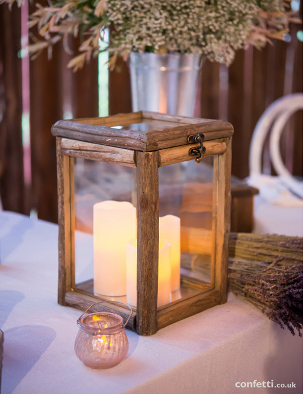 Wooden box centrepiece with white pillar candles| Rustic Wedding Centrepieces for a Barn Wedding | Confetti.co.uk