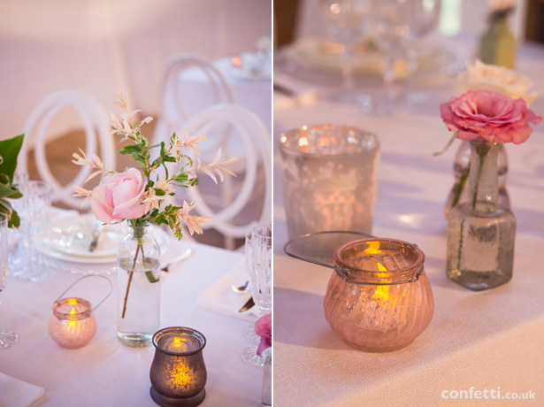 Rustic themed wedding decor | vintage candle holders and clear glass bottle centrepiece | Barn Wedding | Confetti.co.uk