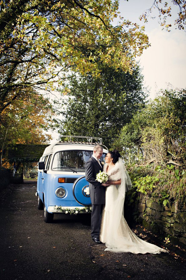 Styling Autumn Wedding |Image courtesy of Lisa Aldersley | Real Wedding Bride and Grooms Autumn Wedding | Autumn bride in lace wedding dress and faux fur cape | VW Campervan Vintage Wedding Transport |Confetti.co.uk