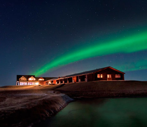 Nestle up with your spouse beneath Iceland's natural lights display on your honeymoon. | Confetti.co.uk