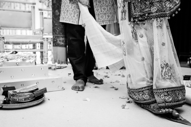 Bride and groom walking round the sacred fire | Traditional Hindu wedding customs | Confetti.co.uk