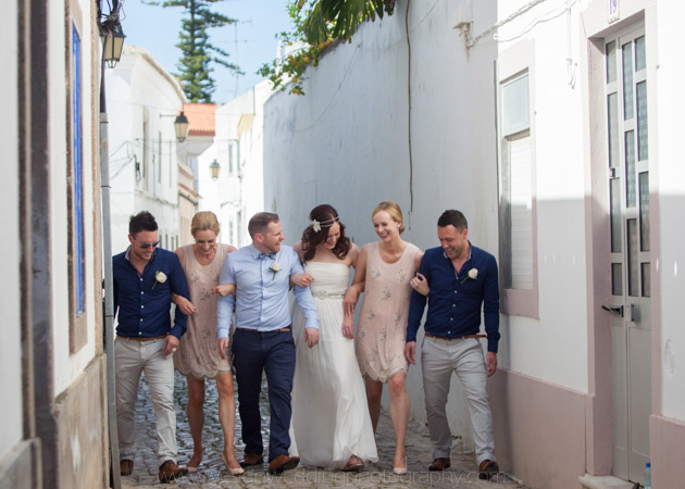 How to Choose Your Bridesmaids | Bride and groom with their bridesmaids and groomsmen in Portugal | Confetti.co.uk