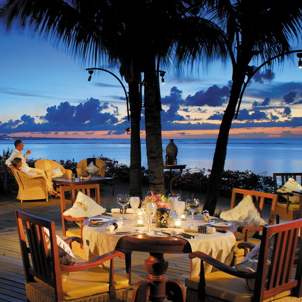 Mauritius dining area with ocean view at twilight | Confetti.co.uk