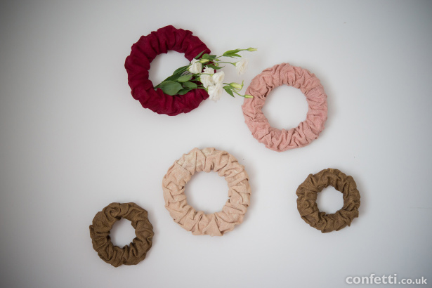 Decorative wall wreaths for weddings in pink, ivory, red, and gold | Confetti.co.uk