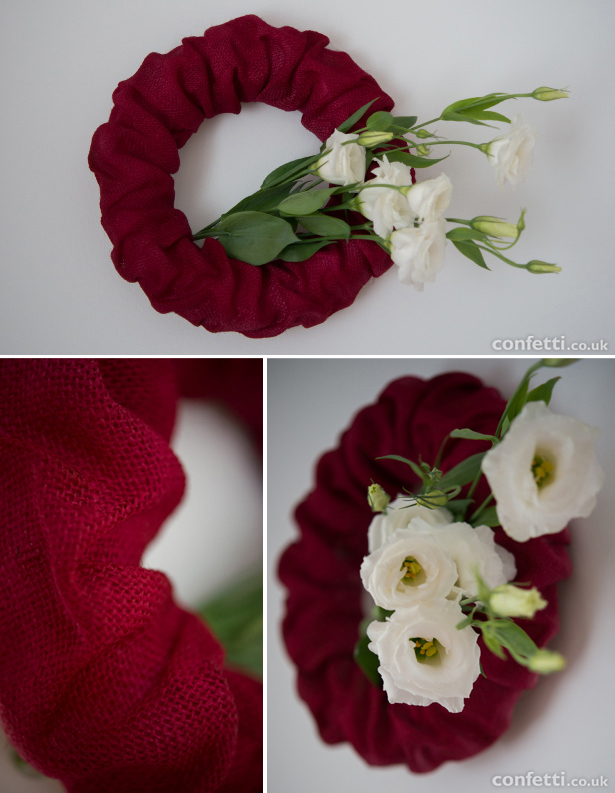 Cranberry red wreath with bunched white flowers | Confetti.co.uk