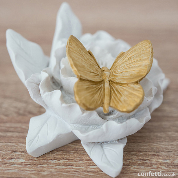 Gold-painted butterfly decoration | Confetti.co.uk