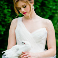 Bride holding a white dove | Confetti.co.uk