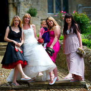 Bride and bridesmaids in wedding flip flops
