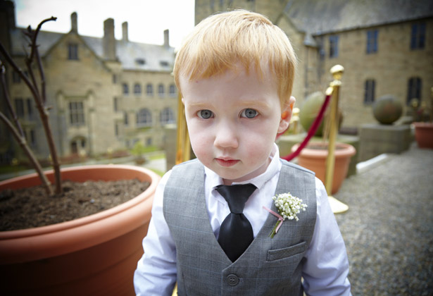 Dapper page boy with buttonhole at Bangor University wedding venue | Confetti.co.uk