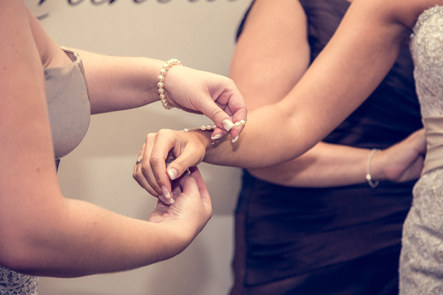 Bridesmaids helping the bride with her wedding accessories   Becki and Rob's Real Wedding By Jenny Martin Photography   Confetti.co.uk