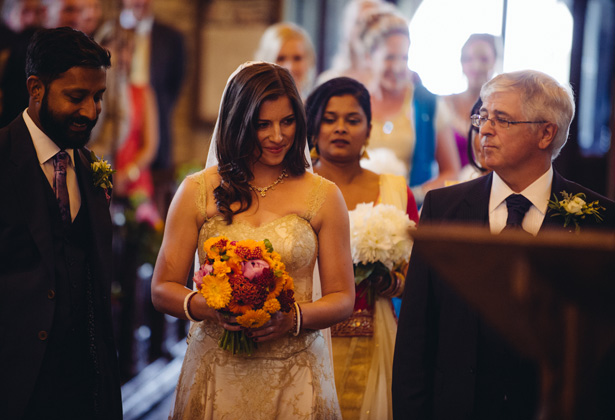The bride and groom together at the altar | Francesca & Arun's Fusion Real Wedding | Confetti.co.uk
