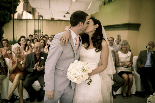 The first kiss as husband and wife | Morgan and James Real Wedding By Infinity Weddings | Confetti.co.uk