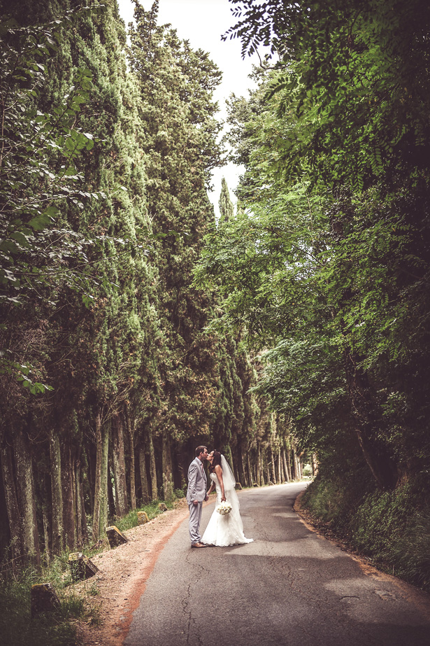 Official wedding shot in the forest | Bride and groom kissing | Morgan and James Real Wedding By Infinity Weddings | Confetti.co.uk