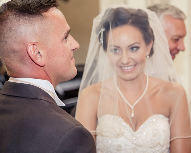 The bride and groom at their ceremony | Becki and Rob's Real Wedding By Jenny Martin Photography | Confetti.co.uk