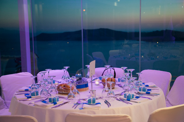 Blue and white wedding table decor | Tiffany blue boxed wedding favours | Wedding reception at the Pantheon villas Santorini | Dasha and Steve's Real Wedding In Greece | Marryme in Greece | Confetti.co.uk