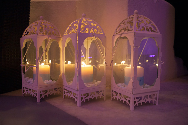 White Moroccan lamps with candles| Wedding reception at the Pantheon villas Santorini | Dasha and Steve's Real Wedding In Greece | Marryme in Greece | Confetti.co.uk