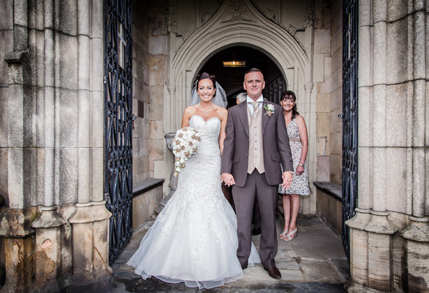 The newlyweds outside the church | Becki and Rob's Real Wedding By Jenny Martin Photography | Confetti.co.uk