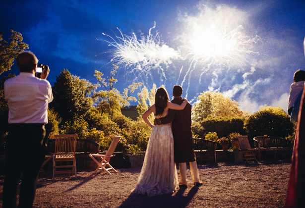 Bride and groom watching the fireworks display | Francesca & Arun's Fusion Real Wedding | Confetti.co.uk