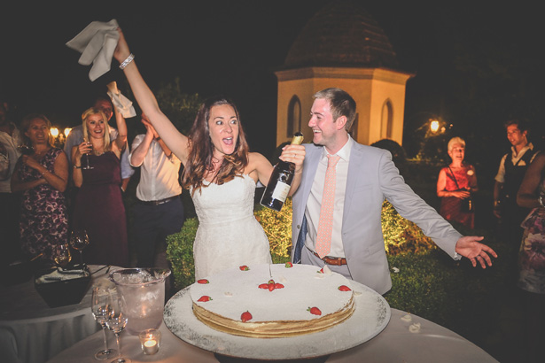Bride and groom celebrating with champagne| Wedding reception at Villa Bucciano , Tuscany | Morgan and James Real Wedding By Infinity Weddings | Confetti.co.uk