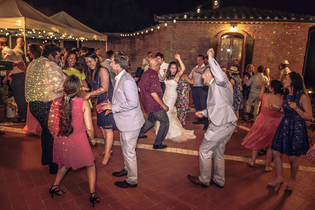Guest dancing at the wedding reception at Villa Bucciano , Tuscany | Morgan and James Real Wedding By Infinity Weddings | Confetti.co.uk