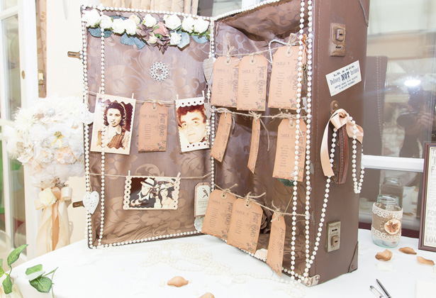 Vintage suitcase place card holder with pearls and vintage photos  Becki and Rob's Real Wedding By Jenny Martin Photography   Confetti.co.uk