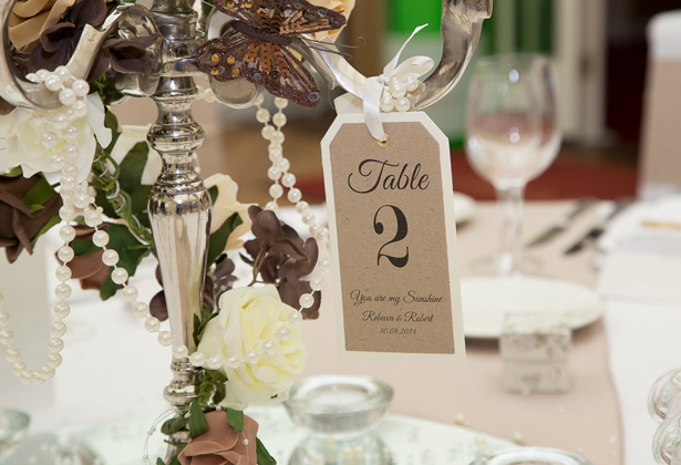 Vintage tag table number | Silver candelabra with brown and white deco| Becki and Rob's Real Wedding By Jenny Martin Photography | Confetti.co.uk
