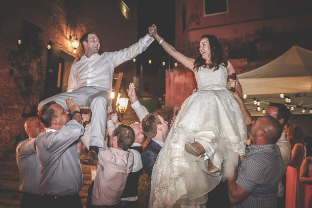 Wedding guests lifting the bride and groom | Morgan and James Real Wedding By Infinity Weddings | Confetti.co.uk