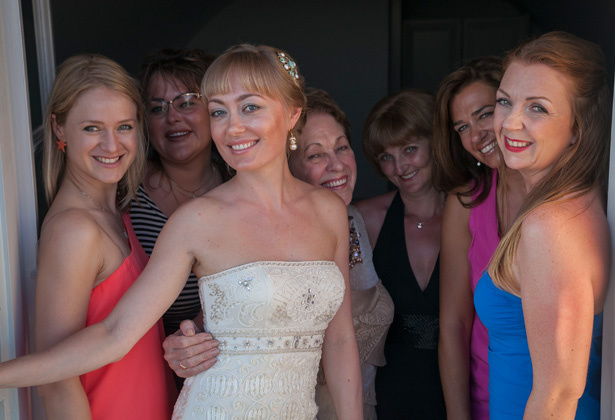 Bride with her bridesmaids|  Bride in a strapless, ivory, frilled wedding dress by Sue Wong| Dasha and Steve's Real Wedding In Greece | Marryme in Greece | Confetti.co.uk