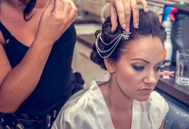 Makeup artist putting the final touches to the brides look   Silver vintage head piece   Becki and Rob's Real Wedding By Jenny Martin Photography   Confetti.co.uk