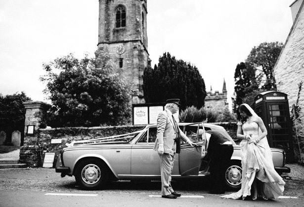Bride, in her gold wedding dress arriving at the church in a vintage Rolls Royce| Francesca & Arun's Fusion Real Wedding | Confetti.co.uk