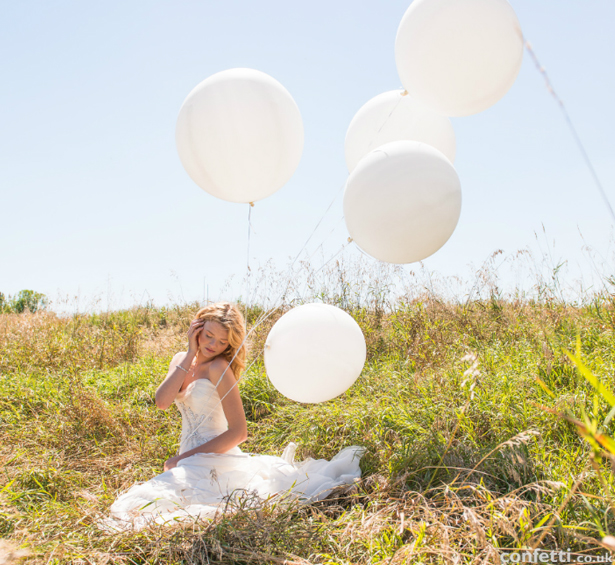 Bride in a summer meadow | Confetti.co.uk