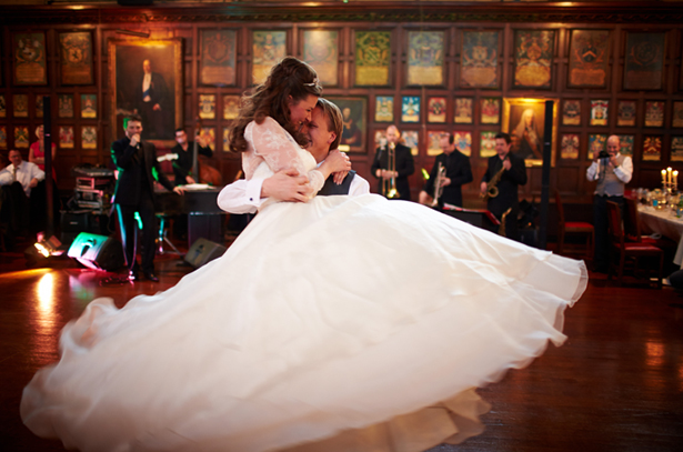 Bride and groom dance to a jazz band | Confetti.co.uk