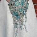 Blue brooch bouquet from Silk Blooms | Confetti.co.uk