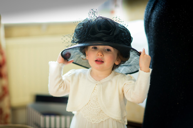 Flower girl wearing the mother of the brides hat | Abigail and Chris's Real Christmas Wedding | Confetti.co.uk