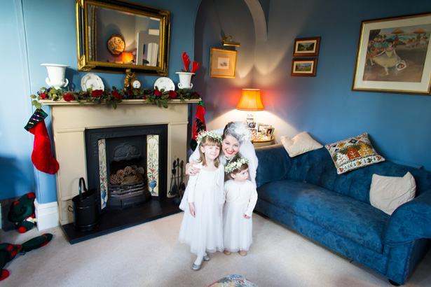 Bride with her flower girls | Abigail and Chris's Real Christmas Wedding | Confetti.co.uk