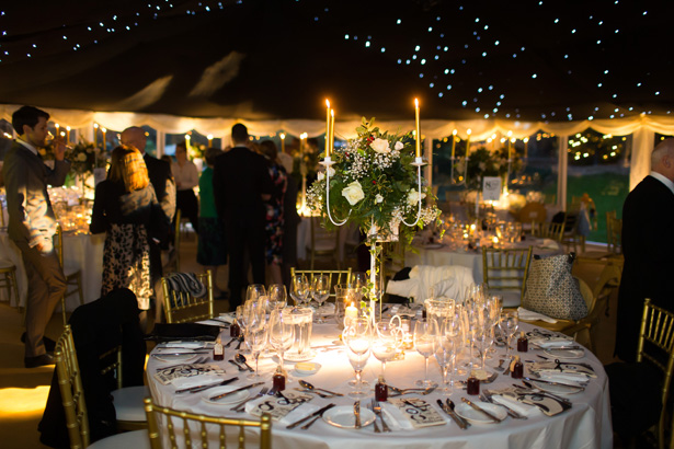 Marquee wedding reception with Christmas themed wedding decor | Abigail and Chris's Real Christmas Wedding | Confetti.co.uk