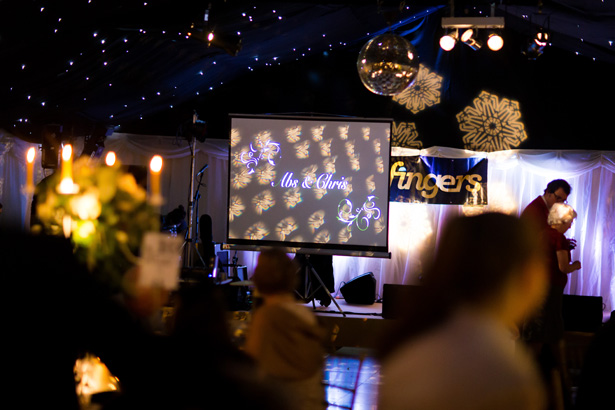 Personalised projector screen with Mr and Mrs | Abigail and Chris's Real Christmas Wedding | Confetti.co.uk