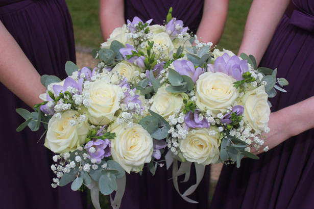 White rose and purple bridesmaid bouquets| Purple themed wedding| Rhiannon & Michael's Real Wedding | Confetti.co.uk
