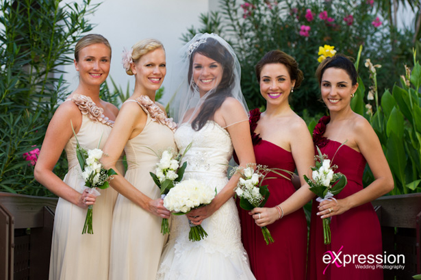 The bride with her 4 bridesmaids | Bridesmaids in Champagne and burgundy dresses |Wedding ceremony at the Sheraton Algarve Hotel, in the Algarve, Portugal.| Debora and James's real destination wedding | Confetti.co.uk