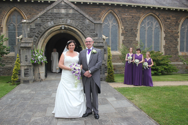 Bride with her father outside Radyr Christ Church| Purple themed wedding| Rhiannon & Michael's Real Wedding | Confetti.co.uk