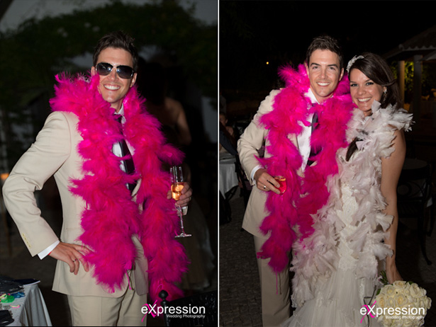 Bride and groom enjoying their wedding reception wearing pink feather boas  | Sheraton Algarve Hotel, in the Algarve, Portugal| Debora and James's real destination wedding | Confetti.co.uk