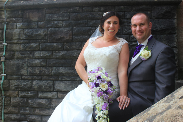 Bride and groom on the staircase outside the church   Purple themed wedding  Rhiannon & Michael's Real Wedding   Confetti.co.uk