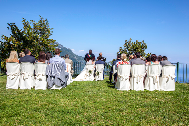 The bride and groom together at the ceremony in Ravello, Italy | Outside wedding ceremony ideas | Leanne and Chris's Real Italian Wedding | Confetti.co.uk