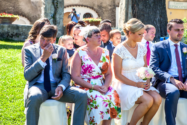 Emotional wedding guests  at the ceremony in Ravello, Italy | Outside wedding ceremony ideas | Leanne and Chris's Real Italian Wedding | Confetti.co.uk